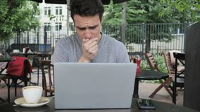 Sick Young Working Man Coughing while Sitting in Cafe Terrace stock images