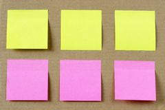 Sicker notes. Six colored (yellow and pink) notes on cardboard Royalty Free Stock Photo