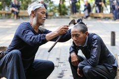 Sickle haircut in ba sha miao village,guinzhou,china Royalty Free Stock Image