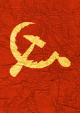 Sickle and hammer. On the compressed silk of gold and red color  - Soviet symbol Royalty Free Stock Photography