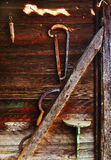 Sickle and Saw on Wood Wall Royalty Free Stock Images