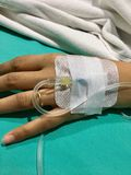 Patient hands to saline. Sickness in hospital hand and saline Royalty Free Stock Image