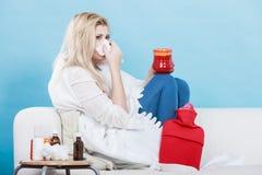 Woman being sick having flu lying on sofa Royalty Free Stock Photography