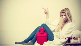 Woman being sick having flu lying on sofa Stock Images