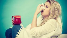 Woman being sick having flu lying on sofa Stock Images