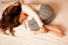 Sickness stomach ache pain period, woman suffering isolated over Stock Photography