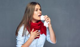 Sickness woman coughing with paper tissue. Ilness girl studio isolated portrait Royalty Free Stock Image