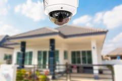 Sicurezza della macchina fotografica della casa del CCTV che funziona alla casa Fotografie Stock Libere da Diritti