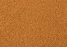 Sida av den orange väggen royaltyfria foton
