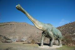 Sida av den stora dinosauren Arkivfoto