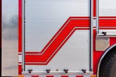 Sida av en brandlastbil royaltyfri foto