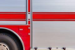 Sida av en brandlastbil royaltyfria foton