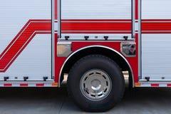 Sida av en brandlastbil arkivbild