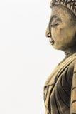 Sida av wood buddha som isoleras på vit bakgrund Arkivbilder