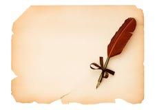 Sida för tomt papper med den antika färgpulverfjäderpennan Arkivbilder