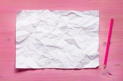 Sida och blyertspenna för tomt papper royaltyfri foto