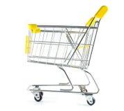 Sidan beskådar shoppingvagnen på vitbakgrund Royaltyfri Fotografi