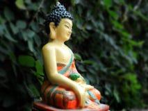 Siddhartha. Statue of Buddha sitting quietly royalty free stock photo