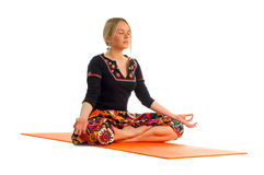 Siddhasana, a position in Yoga, is also called accomplished pose.  royalty free stock images