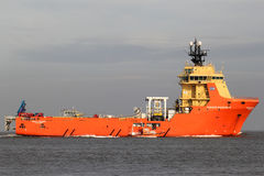 SIDDIS MARINER on the river Elbe. The SIDDIS MARINER is a diesel electric driven supply vessel and pipe carrier, owned and operated by Siem Offshore stock photo