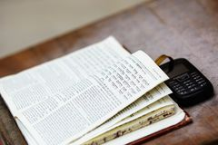 A siddur and a phone Royalty Free Stock Photo