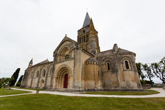 Side, abse and tower views of Aulnay de Saintonge church. In Charente Maritime region of France Royalty Free Stock Image