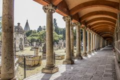 Side aisle and large and small tombs of the cemetery of Belen in Mexico royalty free stock images