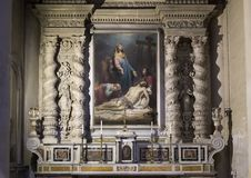 Side Altar of the Duomo Cathedral featuring a painting with Mary mourning over the dead Jesus in Lecce, Italy. Pictured is the side altar of the Duomo Cathedral royalty free stock images