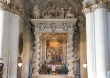 Side Altar of the Duomo Cathedral in Lecce, with a picture of the assumption. Pictured is the side altar of the Duomo Cathedral in Lecce, Italy. It was first royalty free stock photos