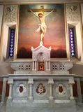 Crucifixion Painting Over the Side Altar. A side altar at the shrine of the Miraculous Medal in Philadelphia is dedicated to the crucifixion of Jesus Stock Photo