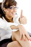 Side angle view of happy accountant with thumbs up Royalty Free Stock Photography