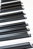 Side angle view of piano keys, shallow depth of field. Close up of piano keys, shallow depth of field, side angle view stock photos