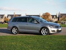 Side angle view of a VW Golf Estate on a autumn day. Tungsten silver Volkswagen Golf MK7 estate, variant, with Team Dynamics Pro Race 3 Alloys. Parked next to royalty free stock photos