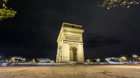 Side of Arc de Triomphe at night Time-Lapse. Wide angle Time Lapse of Arc de Triomphe at night, side view, Paris stock footage