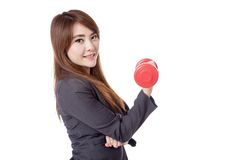 Side of Asian businesswoman happy lift a dumbbell with a hand Royalty Free Stock Images