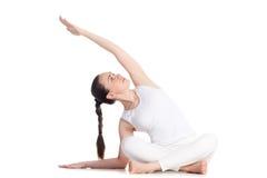 Side bending Sukhasana yoga pose Stock Photo