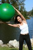 Side Bends. Woman doing side bends with a balance ball Stock Photos