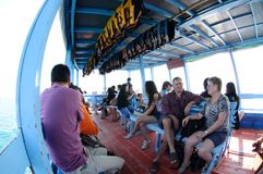 In side big wooden ferry boat with passengers to transport tourists from Rayong to Koh Samed Stock Photo