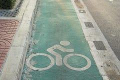 Side bike lane. Green bike lane at side of road in Bangkok, Thailand Royalty Free Stock Image