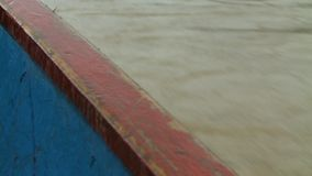 Side of Boat And Water. Steady, close up shot of the side of a canoe boat with water in the background stock video footage