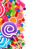 Side border of assorted colorful candies over white Stock Photo