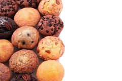 Side border of various muffin cakes white background. Side border of various muffin cakes Stock Photo