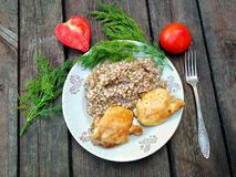 Side. Buckwheat porridge with meat, tomatoes and dill Stock Images