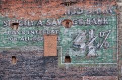 Side of Building in Disrepair. Brick building used for advertising Royalty Free Stock Photos
