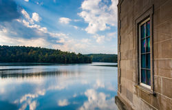 Side of a building and reflections in Prettyboy Reservoir, Balti. More County, Maryland Stock Photo