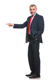 Side of business man pointing Royalty Free Stock Photography