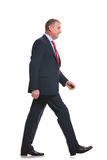 Side of business man walking Stock Images