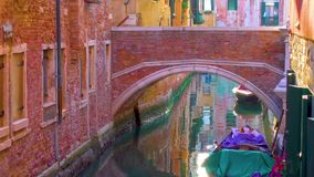 Side canal and bridge in Venice stock video