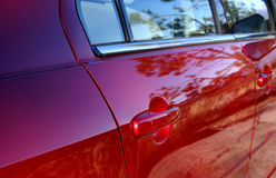 Side of Car. The side panel and door of a red car Royalty Free Stock Photos
