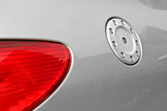 Side of car light and petrol cap. Photo of side of car showing rear brake light lens and petrol cap stock photo